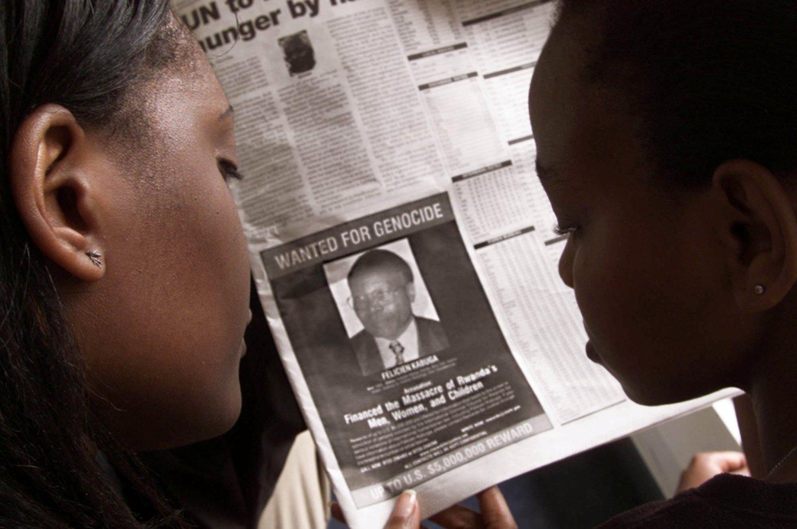 Readers look at a newspaper carrying the photograph of Rwandan Felicien Kabuga wanted by the United States in Nairobi, Kenya, June 12, 2002. (REUTERS Photo)