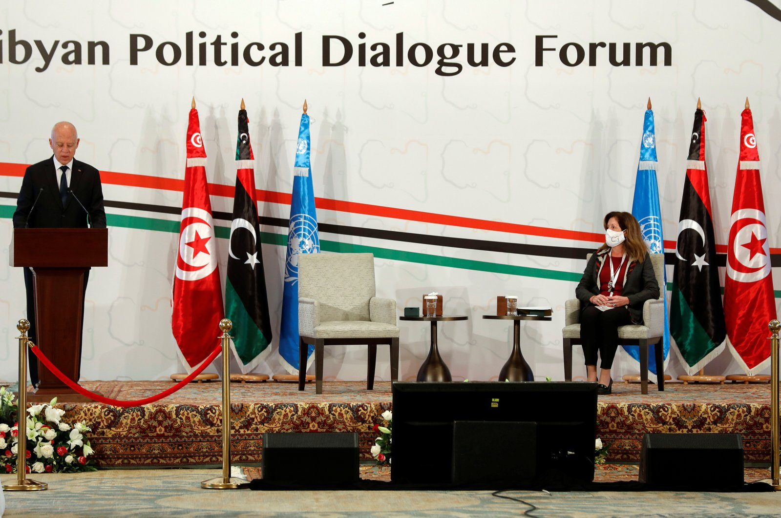 Tunisia's President Kais Saied speaks as Deputy Special Representative of the U.N. Secretary-General for Political Affairs in Libya Stephanie Williams listens to him during the Libyan Political Dialogue Forum in Tunis, Tunisia Nov. 9, 2020. (REUTERS Photo)