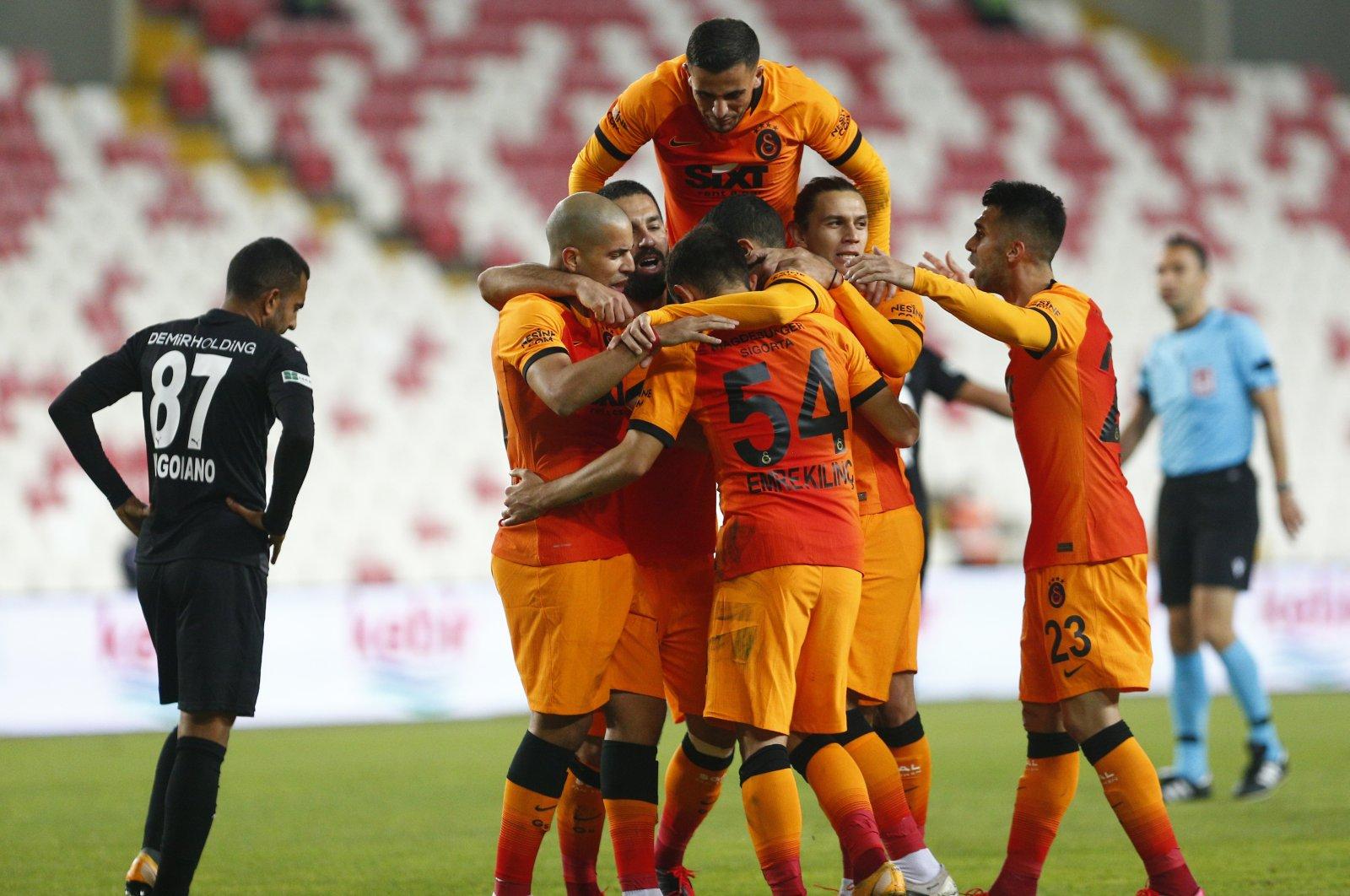Galatasaray players celebrate a goal against Sivasspor during a Süper Lig match in Sivas, Turkey, Nov. 8, 2020. (AA Photo)