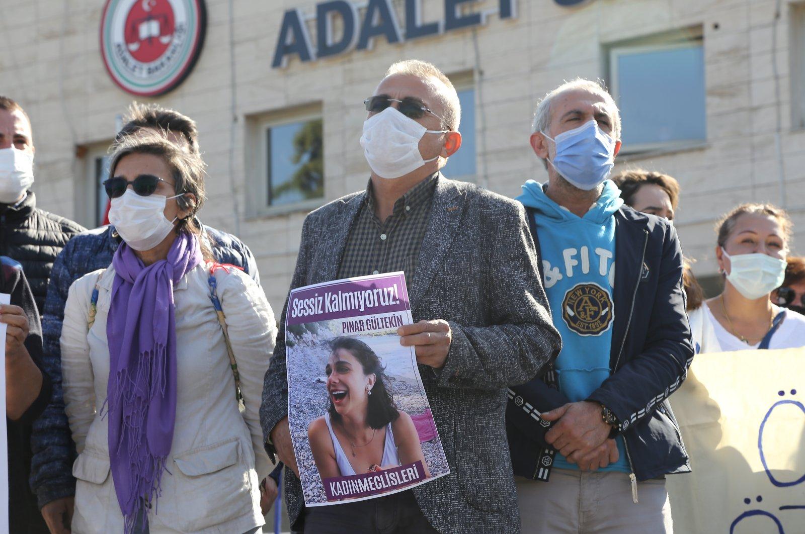 Pınar Gültekin's father Sıddık Gültekin holds her photo outside the courthouse, in Muğla, southwestern Turkey, Nov. 9, 2020. (AA Photo)