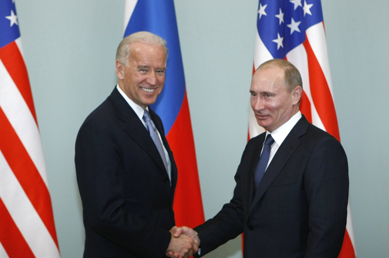Former Vice President of the United States Joe Biden, left, shakes hands with Russian then- Prime Minister Vladimir Putin in Moscow, Russia, March 10, 2011. (AP Photo)