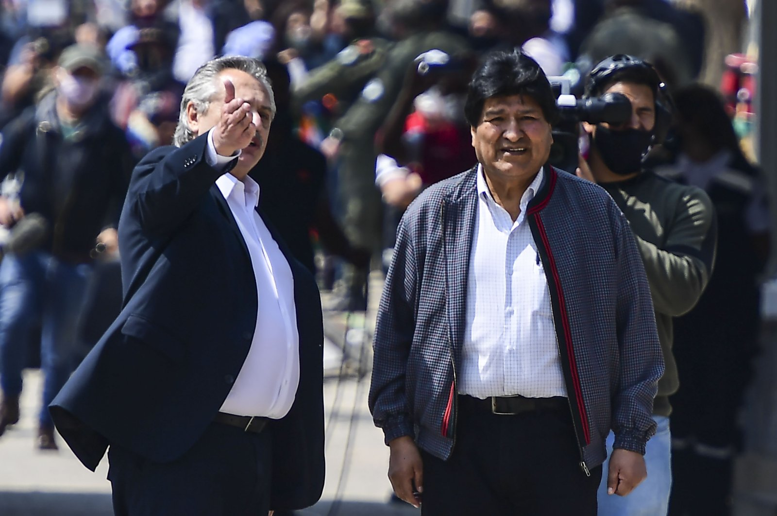Bolivia's former president Evo Morales (R) is accompanied by Argentine President Alberto Fernandez as he arrives back in his country from Argentina, Villazon, Nov. 9, 2020. (AFP Photo)