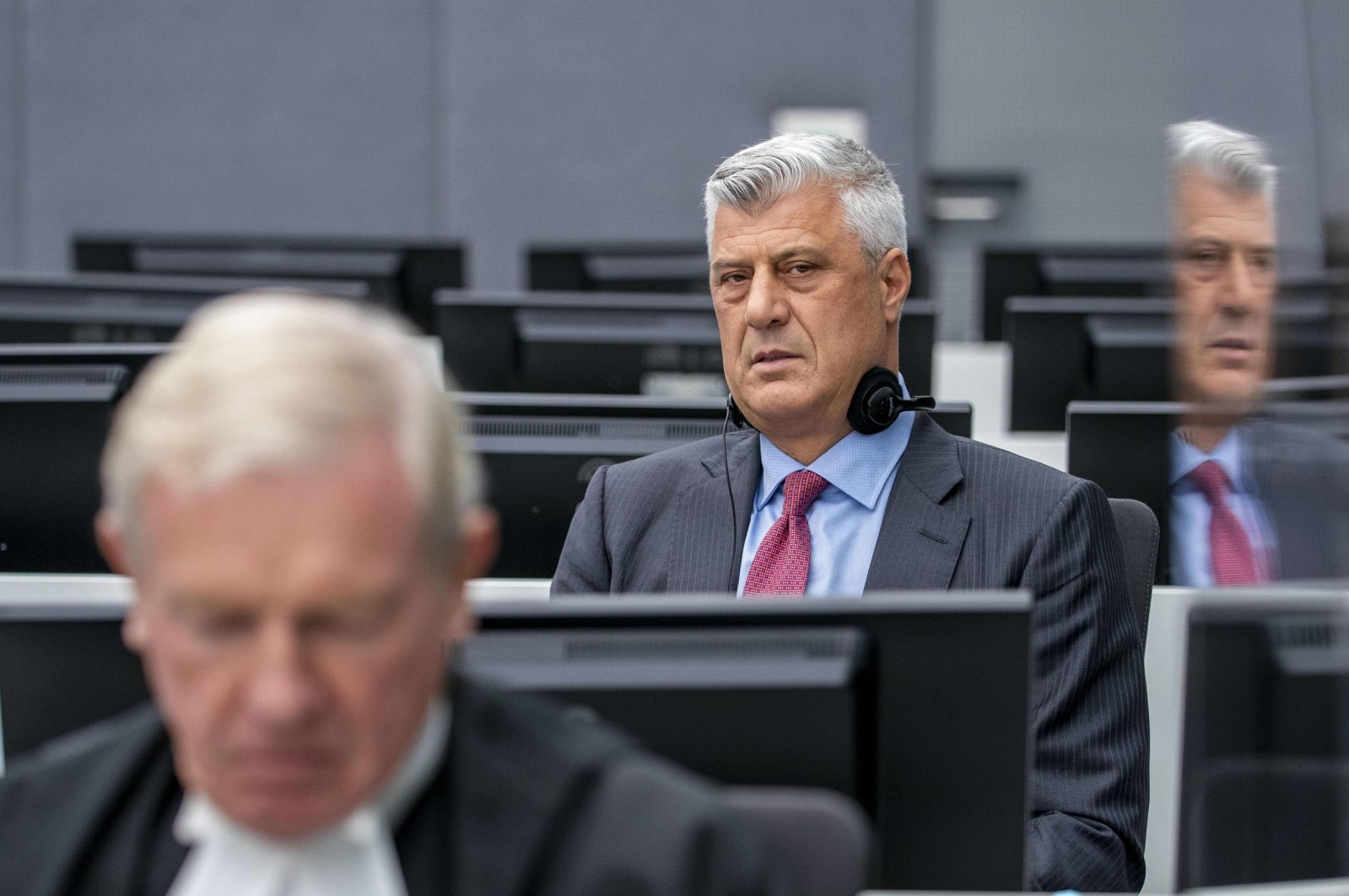 Former Kosovar president Hashim Thaci sits with his lawyer David Hooper (L) for the first time before a war crimes court in The Hague, the Netherlands, to face charges relating to the 1990s conflict with Serbia, Nov. 9, 2020. (AFP Photo)