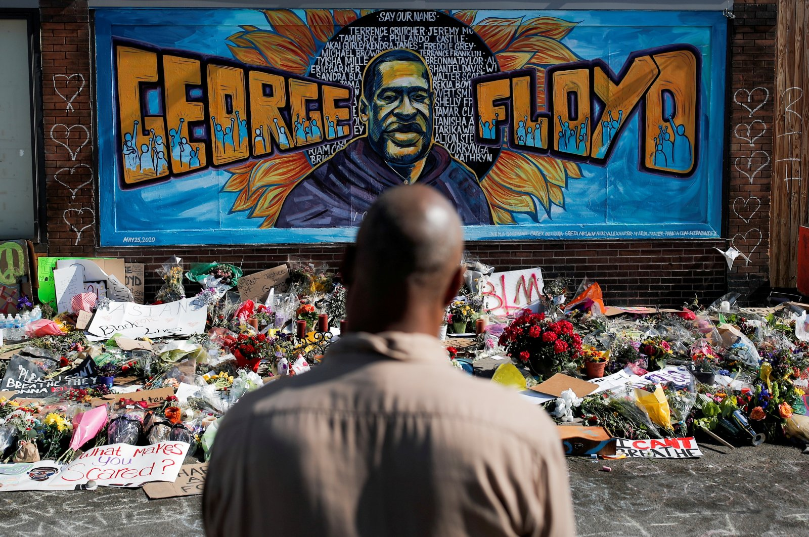 A local resident stands in front of a makeshift memorial honoring George Floyd, at the spot where he was taken into custody, in Minneapolis, Minnesota, U.S., June 1, 2020. (Reuters Photo)