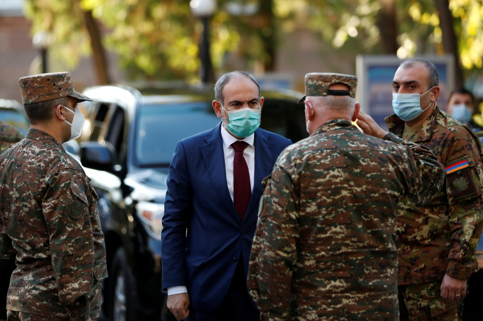 Armenian Prime Minister Nikol Pashinian (C) visits the Central Clinical Military Hospital of the Armenian Defense Ministry, where servicemen wounded during the military conflict over the Armenian-occupied Nagorno-Karabakh region are being treated, in Yerevan, Armenia, Oct. 23, 2020. (Armenian Prime Minister Press Service/PAN Photo via Reuters)