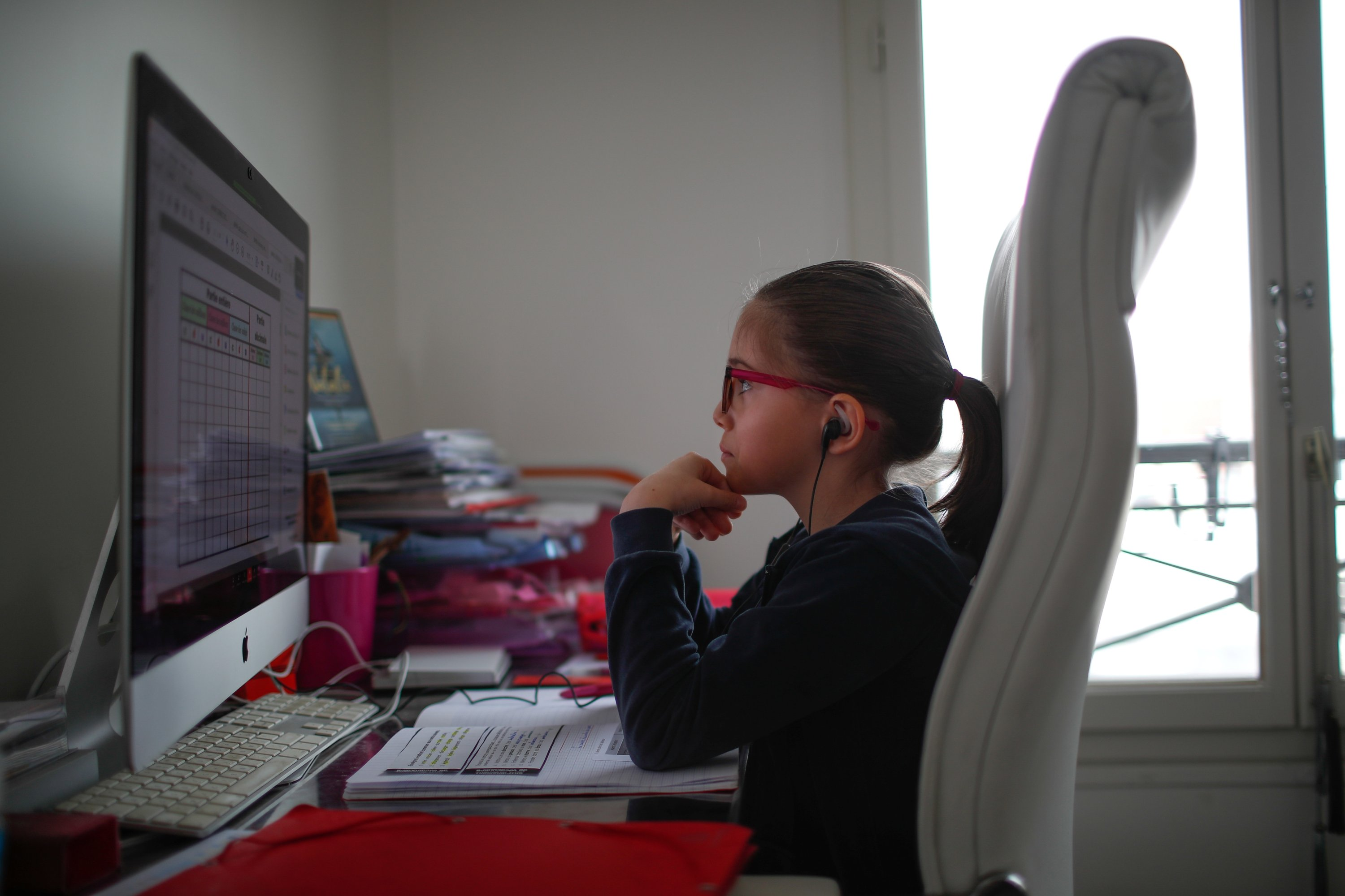A student at the International Bilingual School (EIB) attends her online lessons in her bedroom in Paris, France, March 20, 2020. (Reuters Photo)