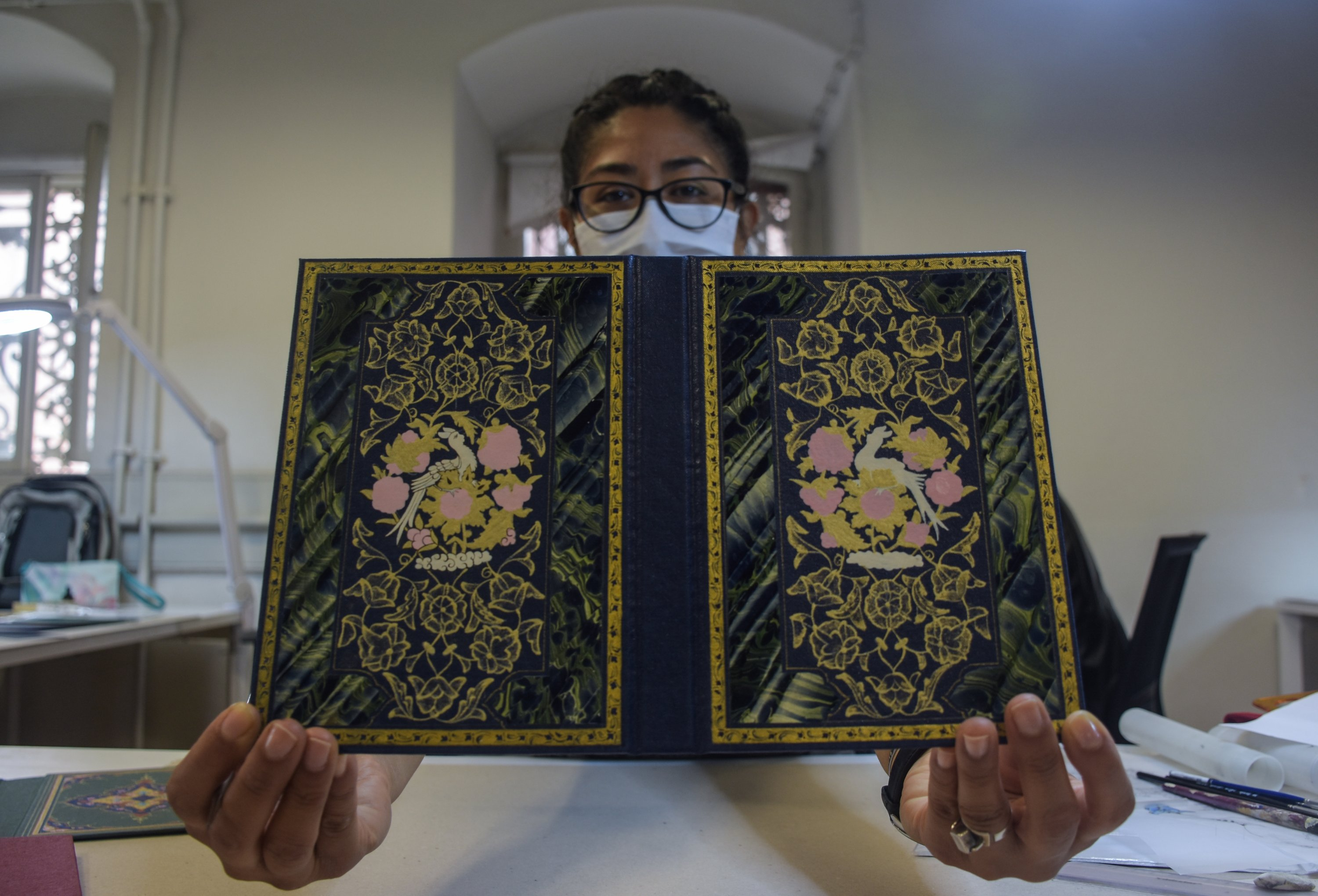 Sofia Chavez holds a book cover that she decorated at the book binding workshop at Dolmabahçe Palace, Istanbul, Turkey, Nov. 9, 2020. (AA Photo)