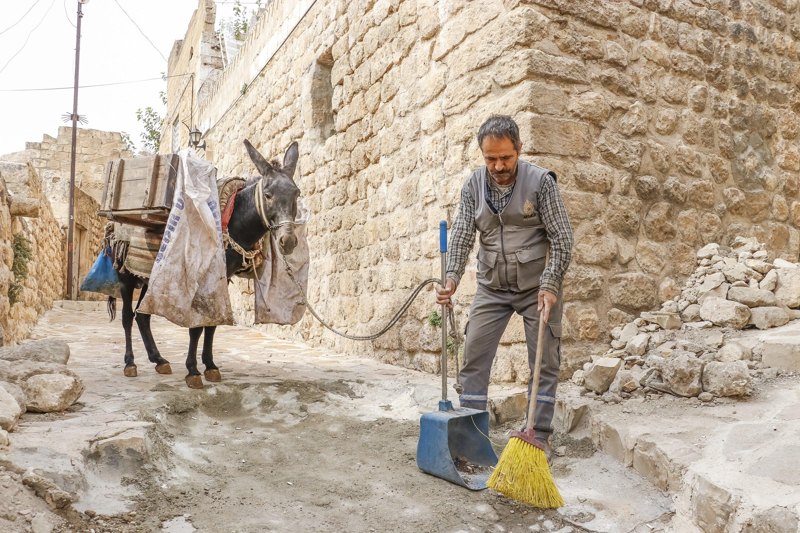 Donkeys shoulder garbage burden in historic district of Turkey's Mardin