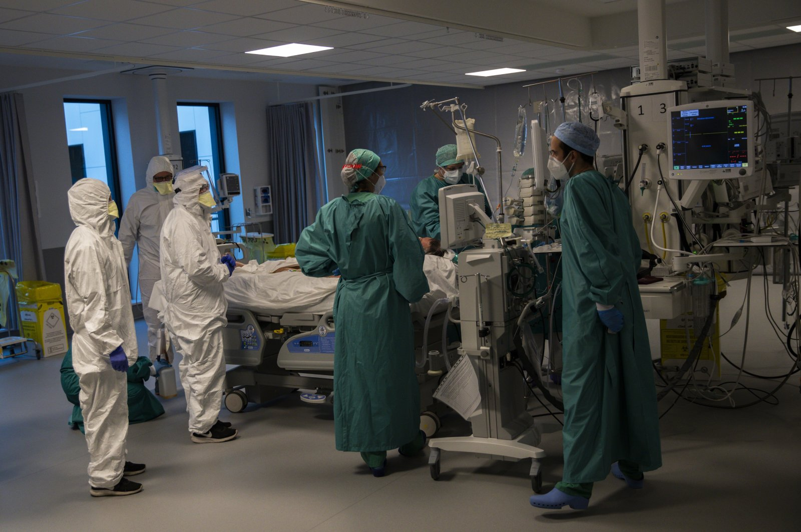 Medical personnel work in the intensive care ward for COVID-19 patients at a hospital in Liege, Belgium, Nov. 6, 2020. (AP Photo)