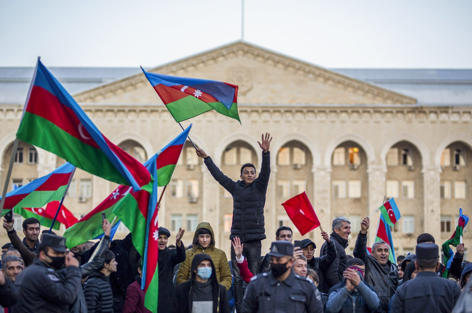 Azerbaijani citizens celebrate the peace deal that is expected to end the 30 yearlong Armenian occupation of Nagorno-Karabakh on Tuesday, Nov. 10, 2020 (AA Photo)
