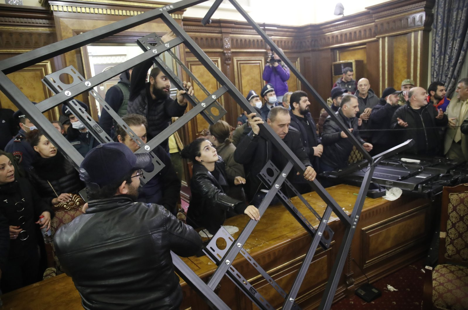 People broke into a government building protesting an agreement to halt fighting over the Nagorno-Karabakh region, in Yerevan, Armenia, Nov. 10, 2020. (AP Photo)