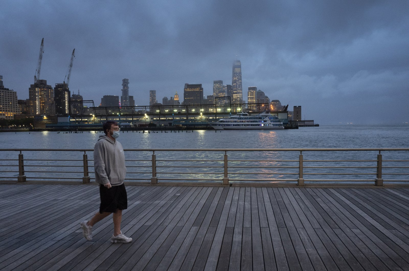In this April 30, 2020, file photo, a man wears a face mask as he walks on Pier 45 in Hudson River Park in New York. (AP Photo)