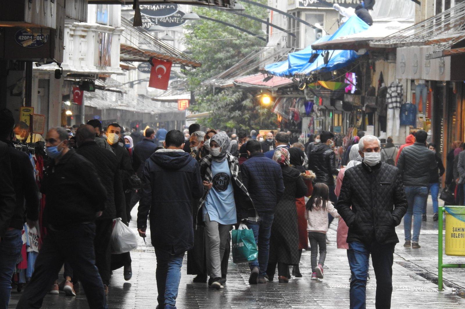 People wearing protective masks walk on a street in Gaziantep, southeastern Turkey, Nov. 5, 2020. (IHA Photo)