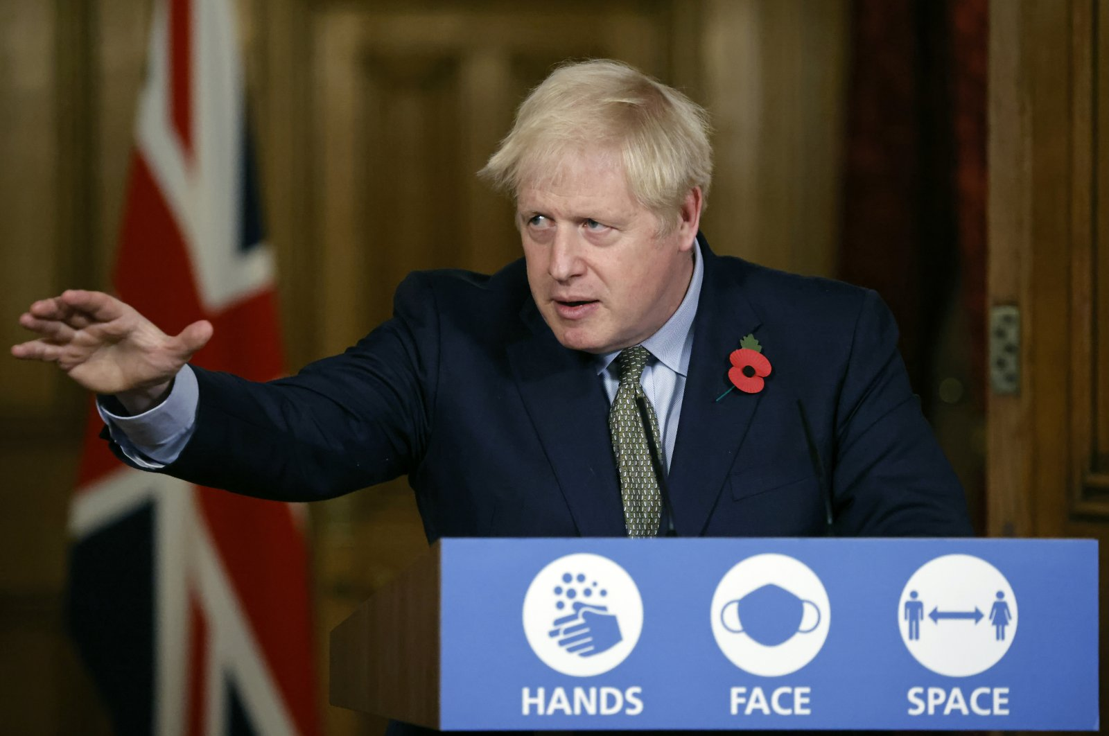 British Prime Minister Boris Johnson reaches out during a virtual press conference at 10 Downing Street, London, Nov. 9, 2020. (AP Photo)
