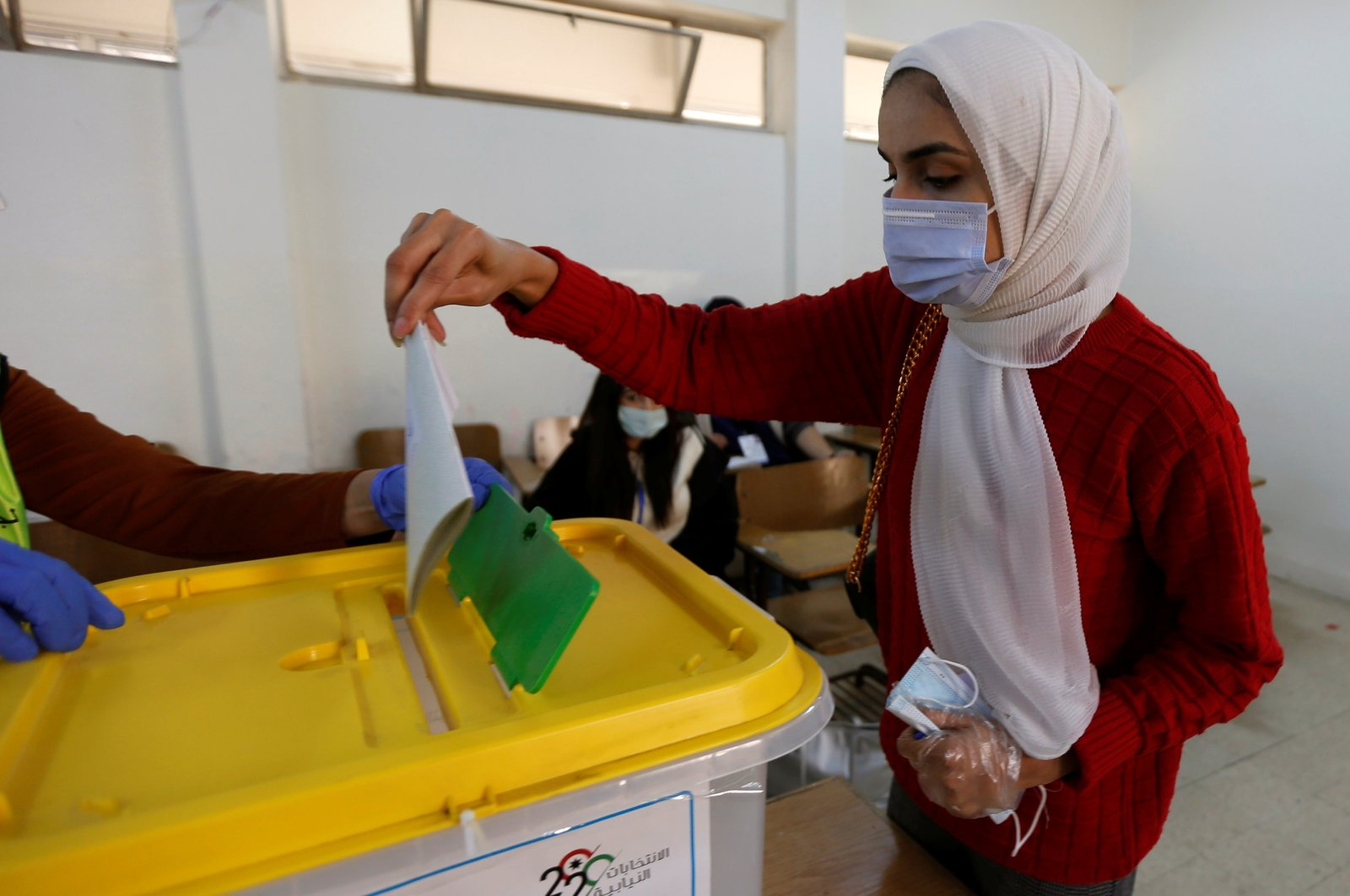 A woman casts her vote during parliamentary elections amid fears over the rising number of coronavirus cases, in Amman, Jordan, Nov. 10, 2020. (Reuters Photo)