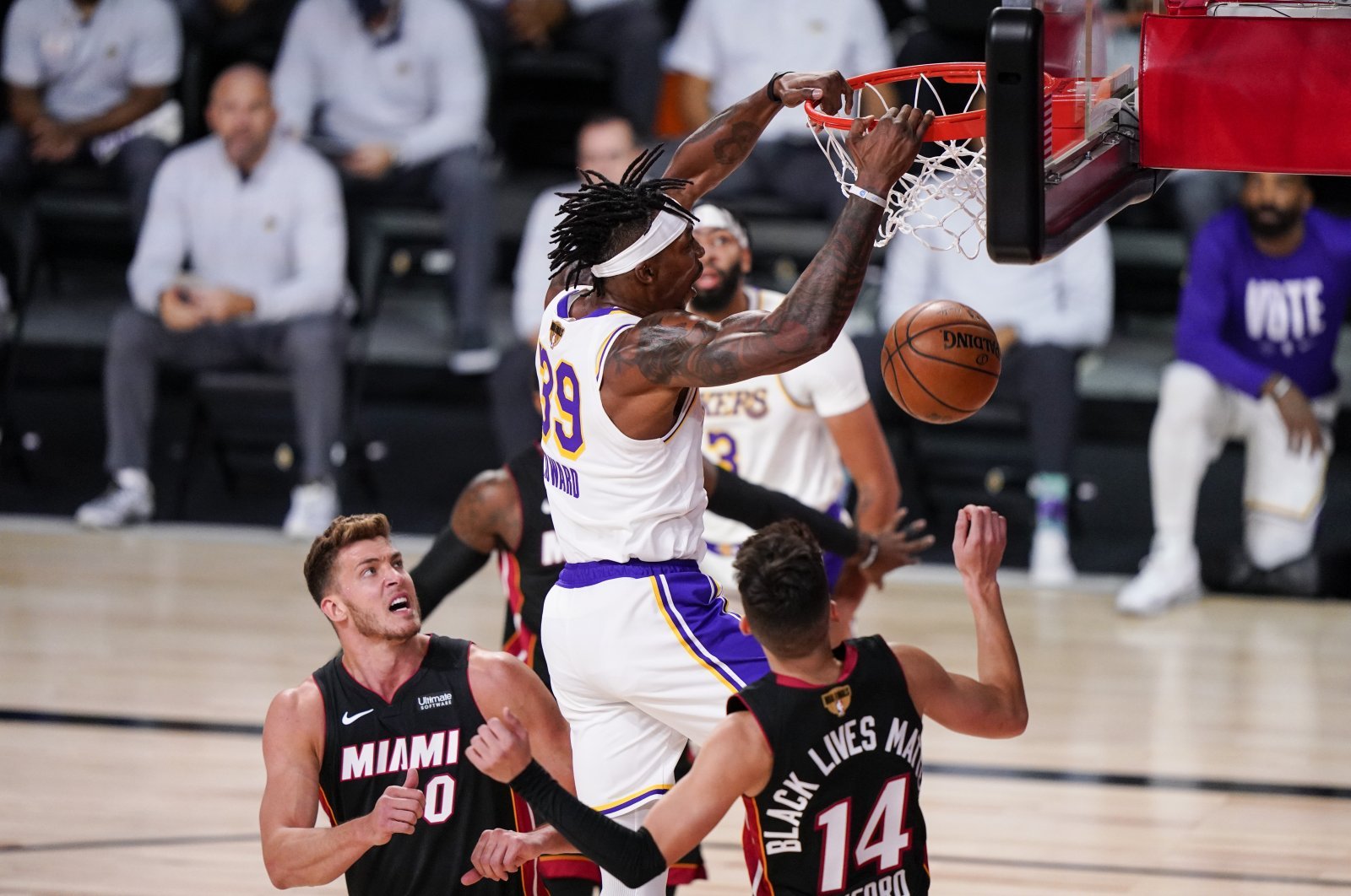 Los Angeles Lakers' Dwight Howard dunks the ball against Miami Heat players during Game 3 of the NBA Finals, in Lake Buena Vista, Florida, U.S., Oct. 4, 2020. (AP Photo)