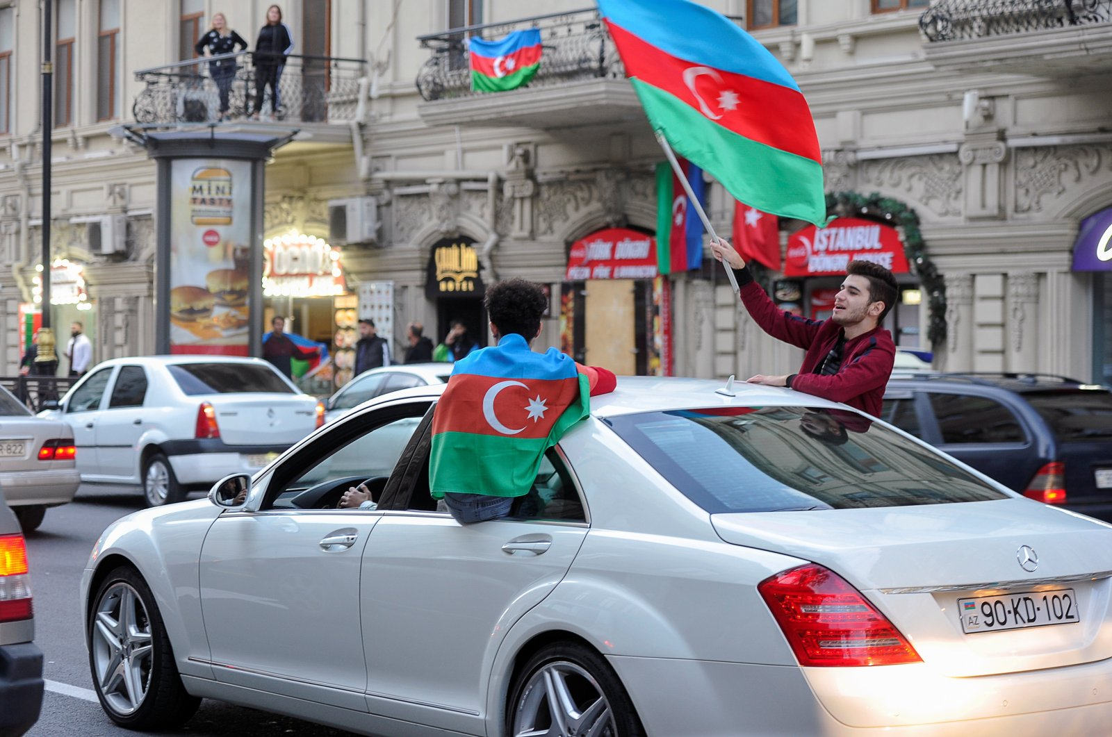 People with Azerbaijani flags ride in a car as they take part in celebrations in a street following the signing of a deal to end the military conflict over the Nagorno-Karabakh region, in Baku, Azerbaijan, Nov. 10, 2020. (Reuters Photo)