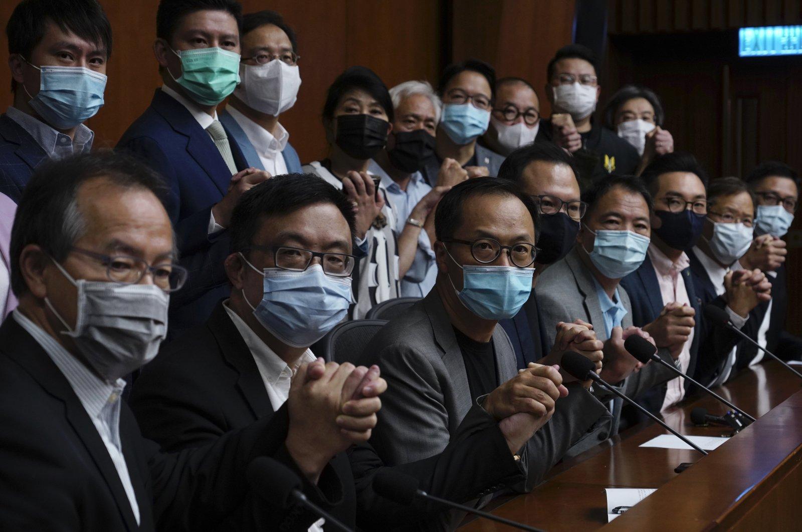 Hong Kong's pro-democracy legislators pose for a picture before a press conference at the Legislative Council in Hong Kong, Nov. 9, 2020. (AP Photo)