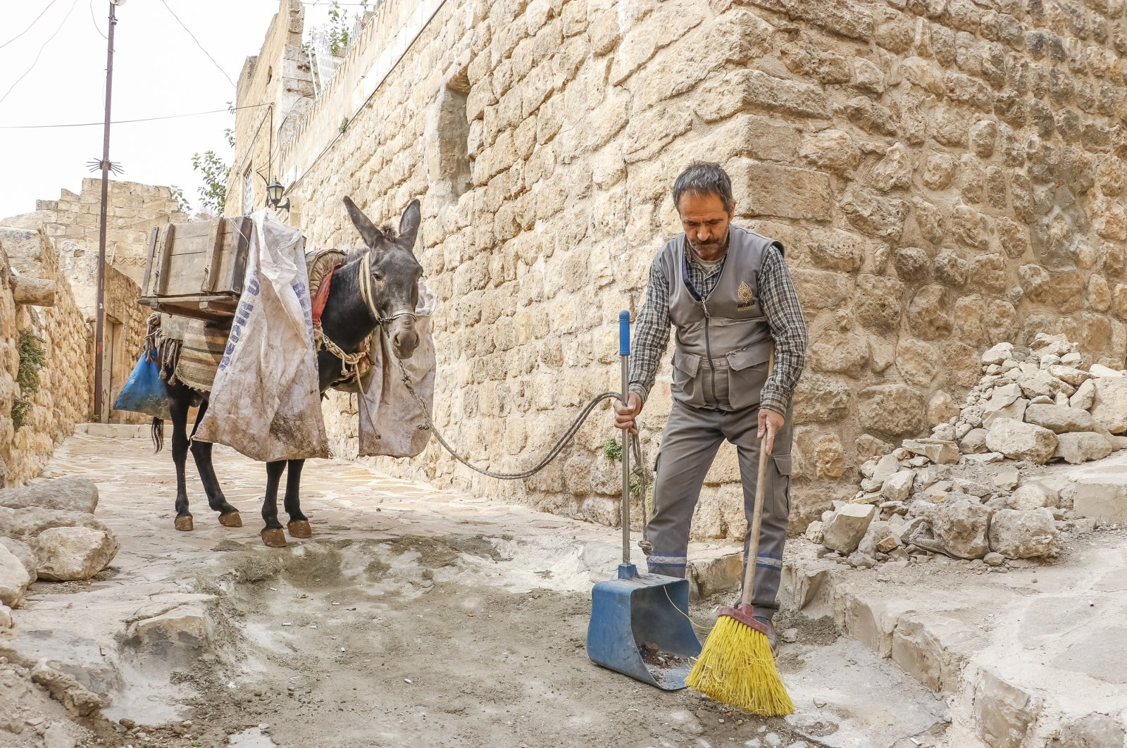 A donkey accompanies a garbage collector in the Artuklu district of Mardin province, southeastern Turkey, Nov. 10, 2020. (DHA Photo)