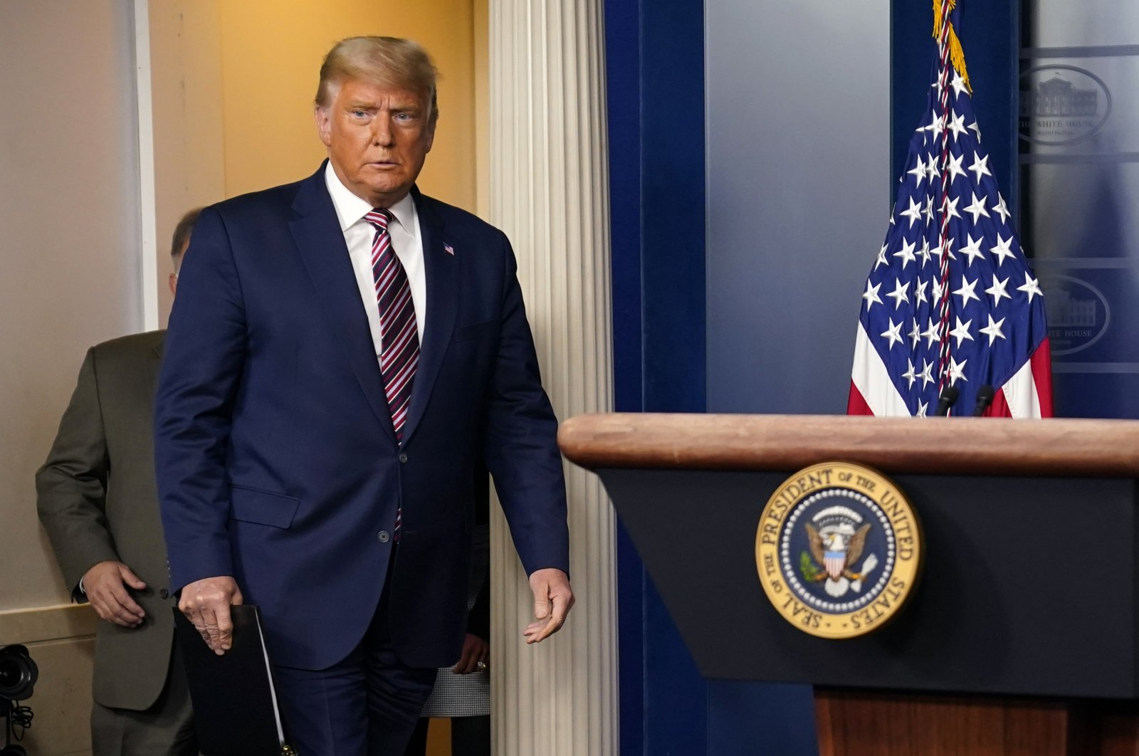 U.S. President Donald Trump arrives to speak at the White House, Washington, D.C., U.S., Nov. 5, 2020. (AP Photo)