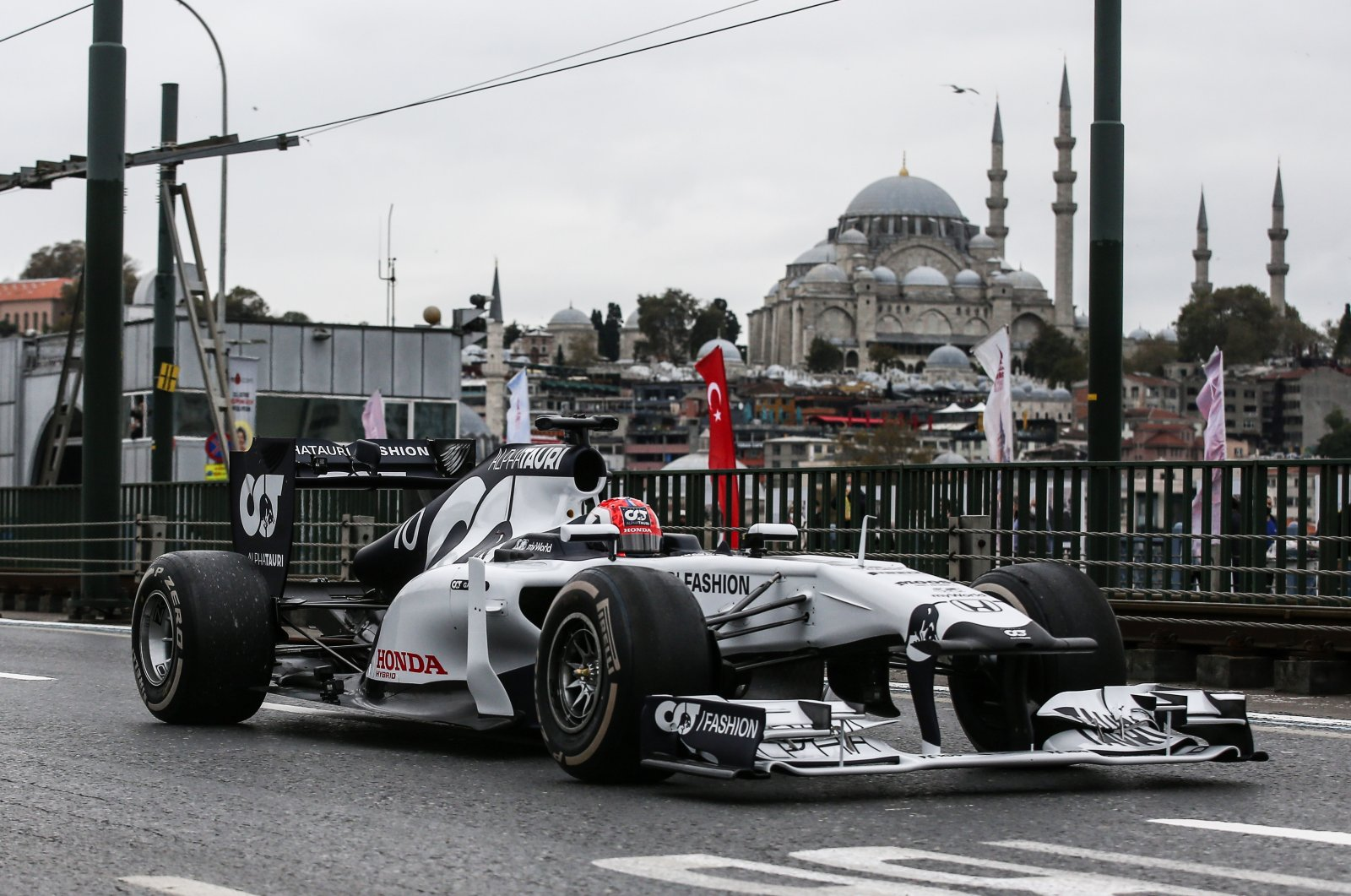 An AlphaTauri Formula One race car crosses Galata Bridge in the historic Eminönü neighborhood of Istanbul, Turkey, Nov. 10, 2020. (AA Photo)