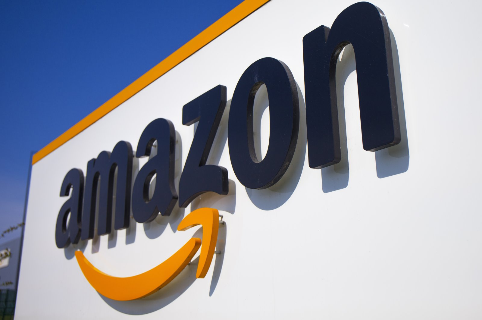 A logo at the entrance of Amazon, in Douai, northern France, April 16, 2020. (AP Photo)