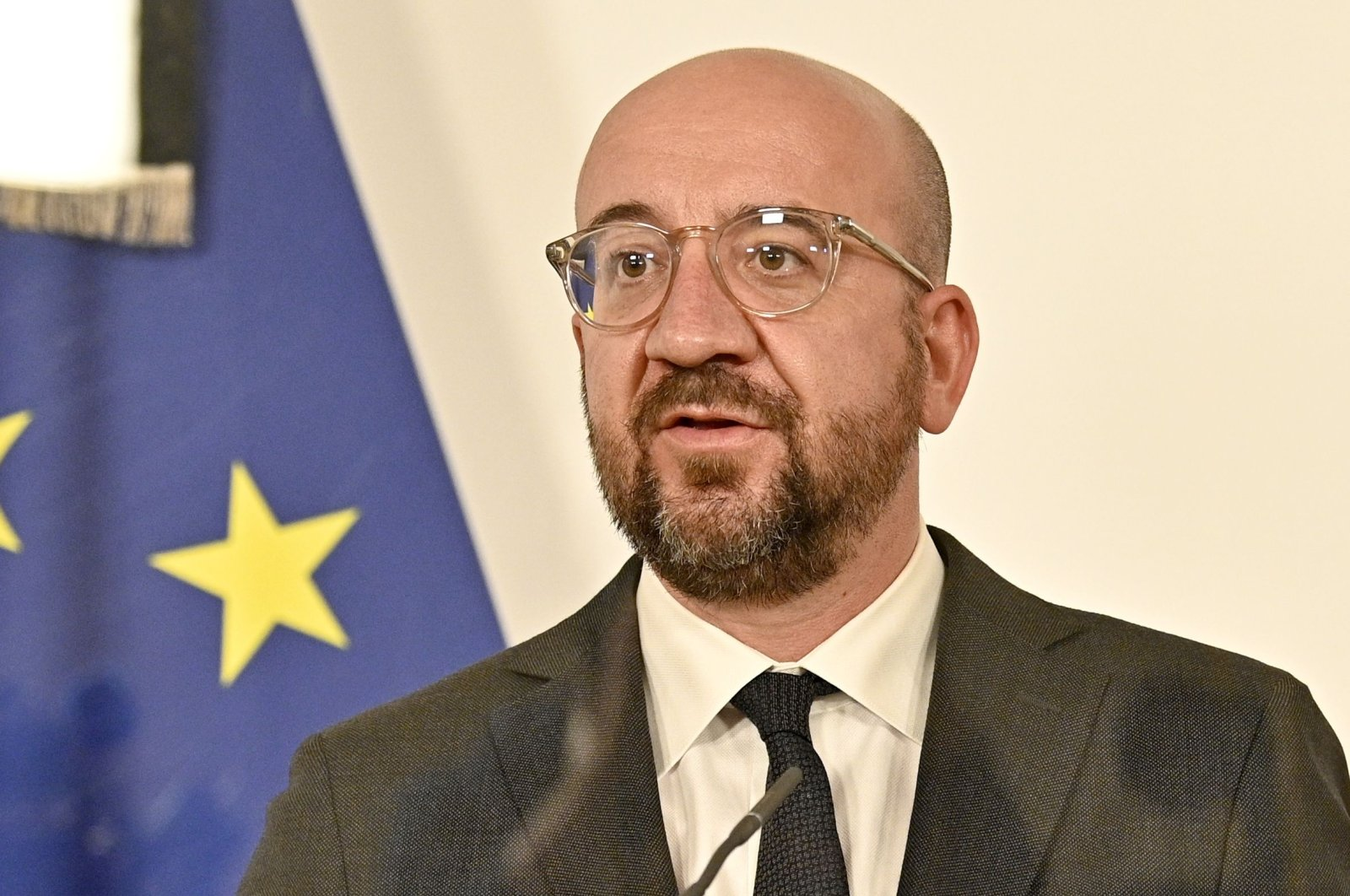 The President of the European Council Charles Michel speaks from behind a protective transparent board during his meeting with Austrian Chancellor in Vienna, Austria, Nov. 9, 2020. (AFP Photo)