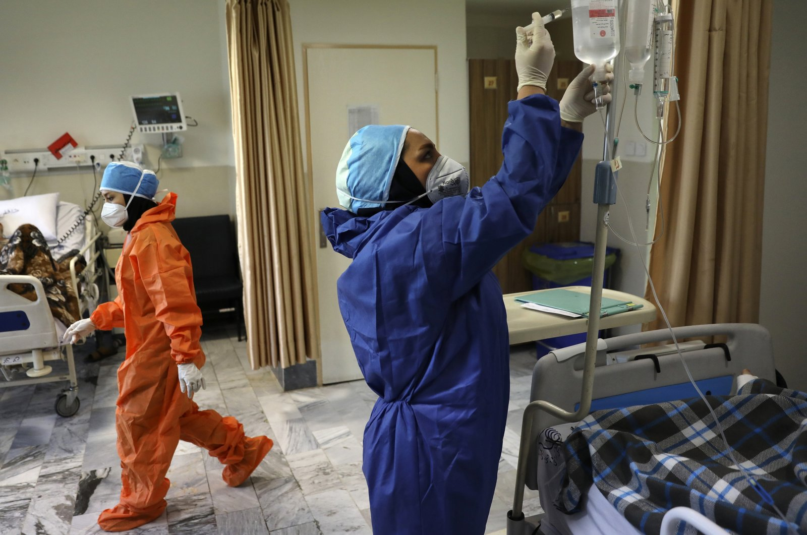 Nurses tend to COVID-19 patients at the Shohadaye Tajrish Hospital in Tehran, Iran, on June 16, 2020. (AP Photo)