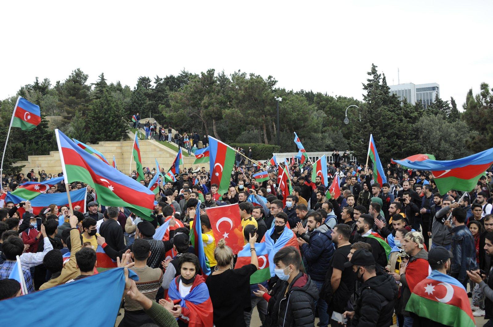 Azerbaijani people celebrate in Baku, Azerbaijan, Nov. 10, 2020. (EPA Photo)