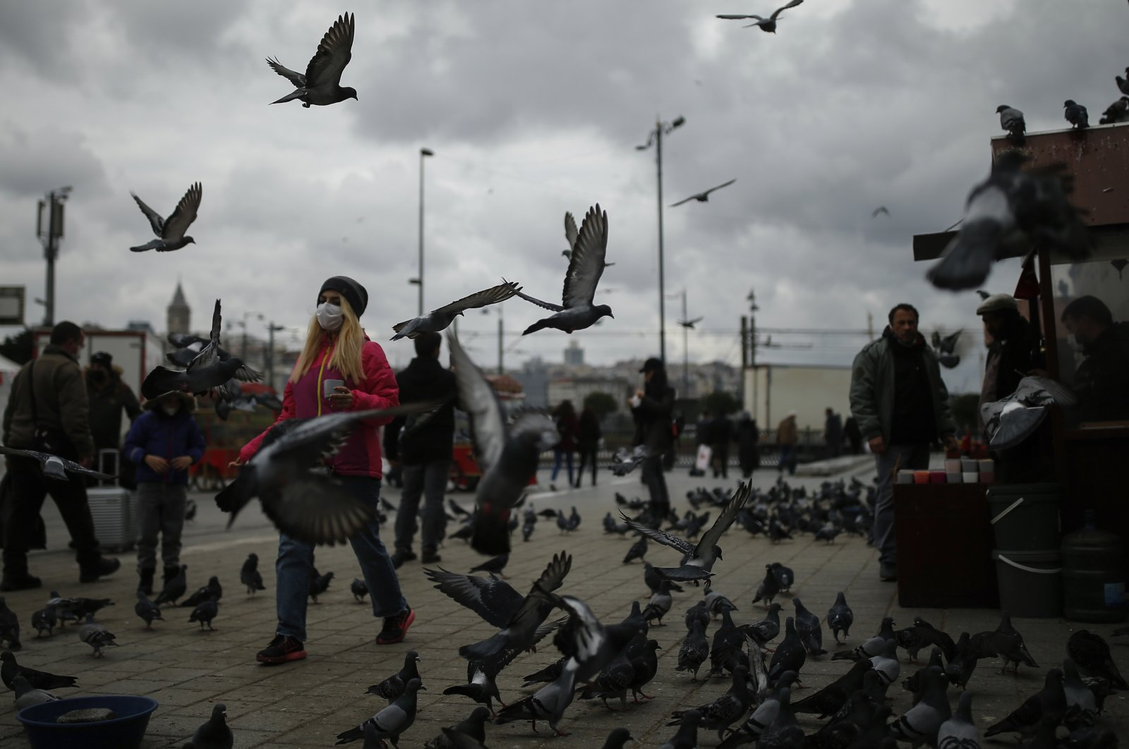 People, most wearing masks to guard against the spread of the coronavirus, walk through Eminönü Market by the Golden Horn in Istanbul, Nov. 10, 2020. (AP Photo)