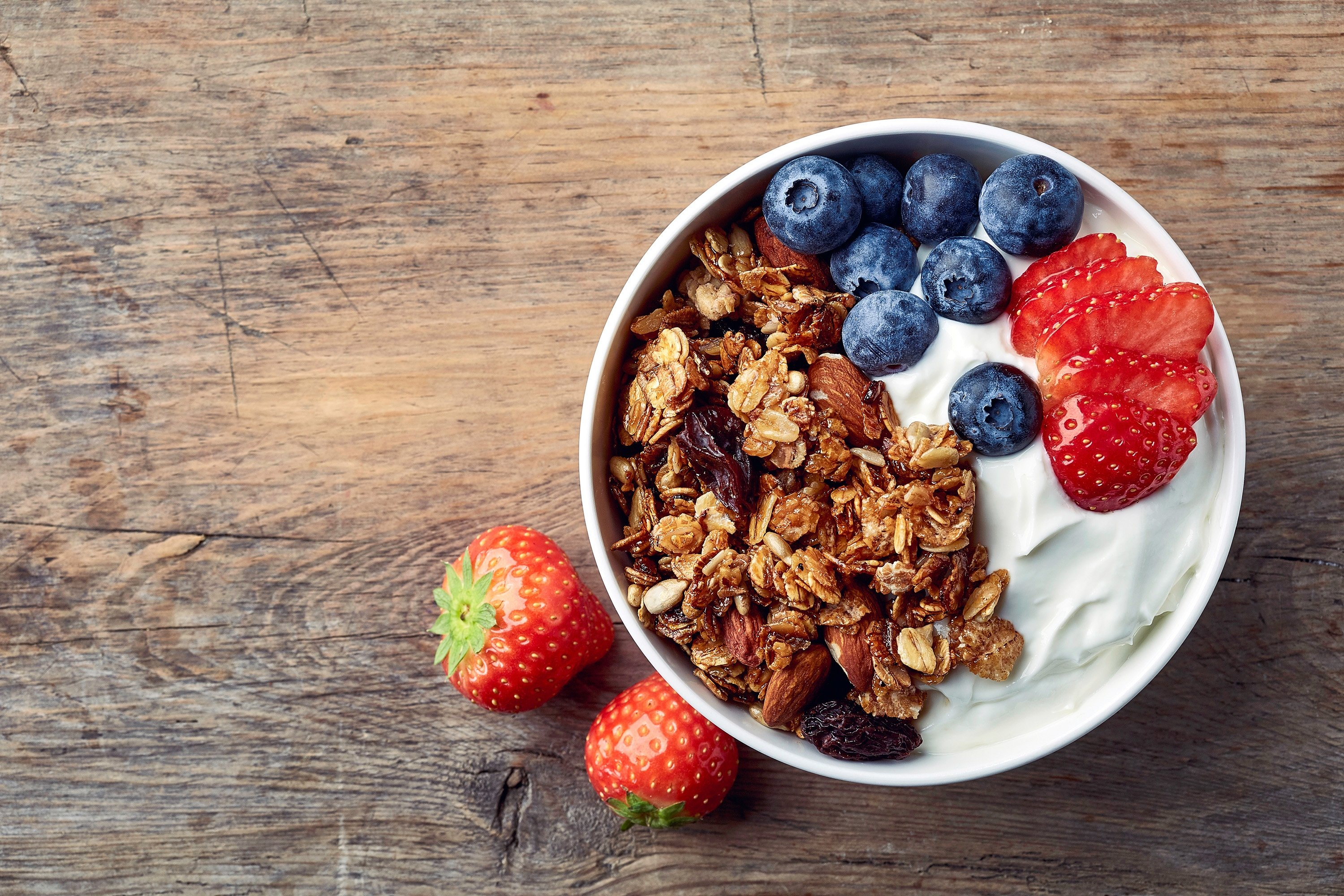 Add some yogurt to your morning granola for a probiotic punch. (Shutterstock Photo)