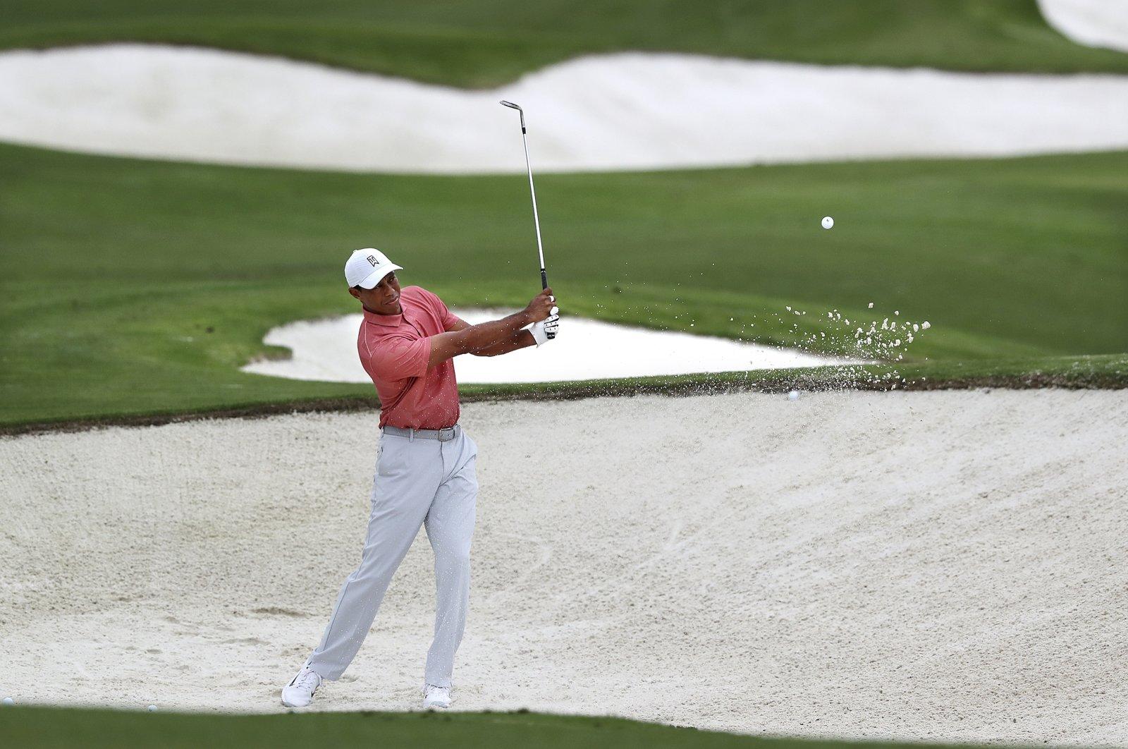 Tiger Woods practices on his sand shots, in Augusta, Georgia, U.S., Nov. 10, 2020. (AP Photo)