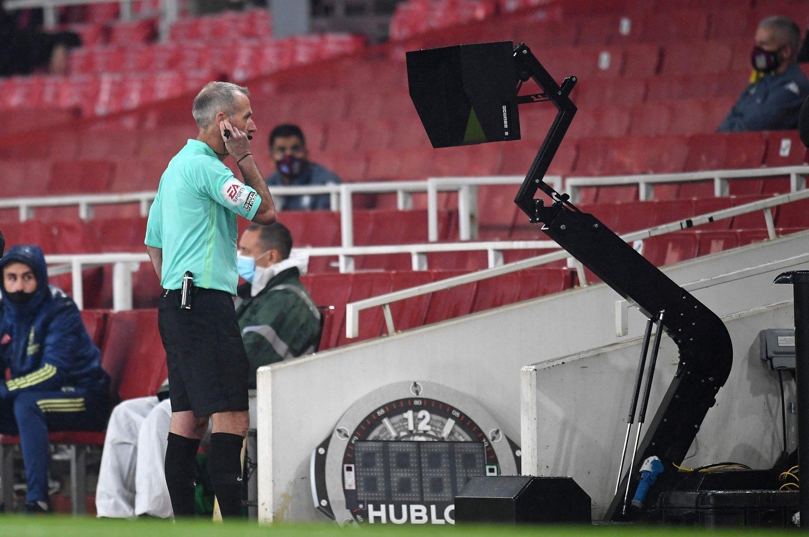 Referee Martin Atkinson reviews a goal by Aston Villa during an Arsenal-Aston Villa game, in London, Britain, Nov. 8, 2020. (AFP Photo)