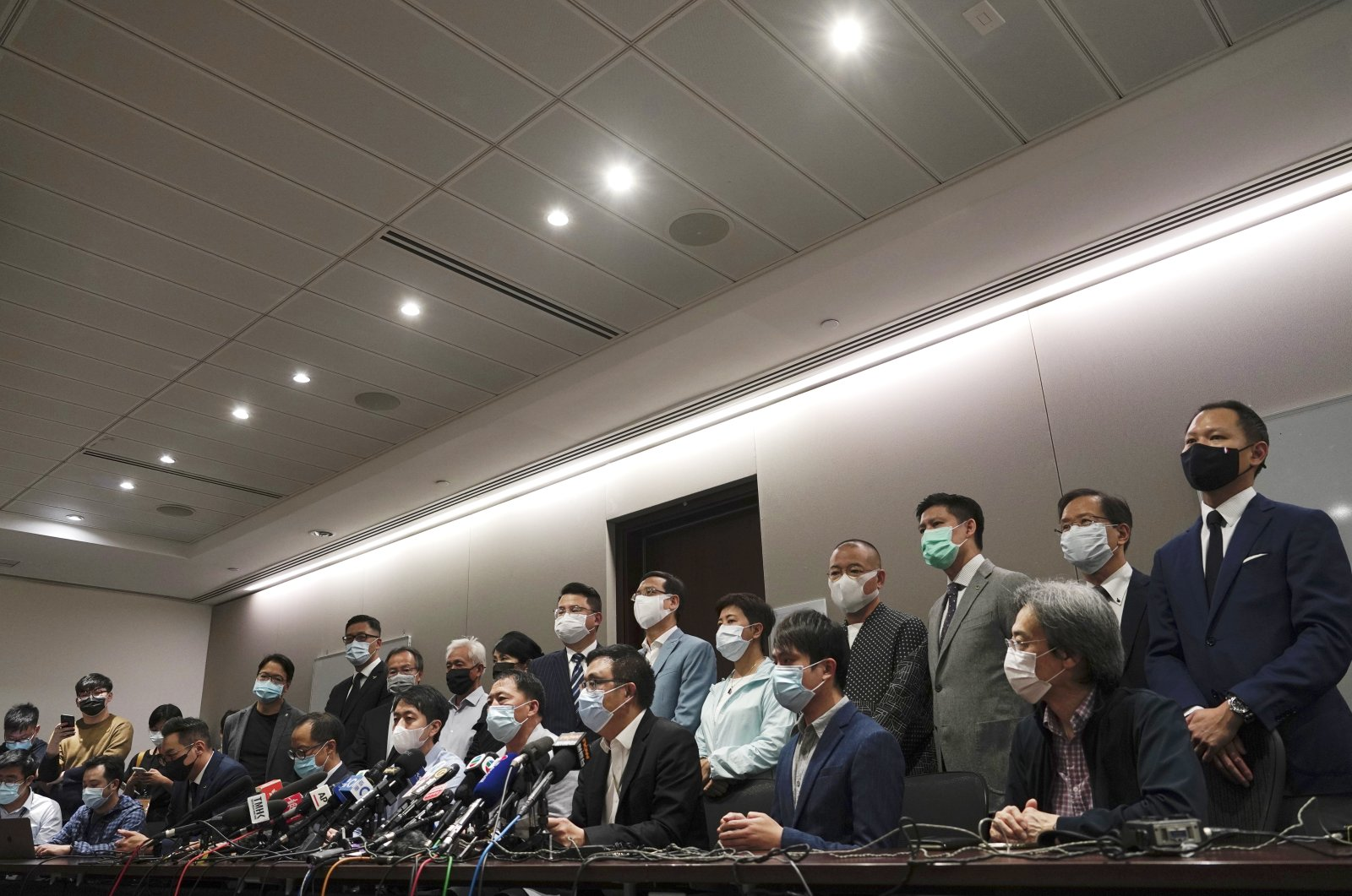 Hong Kong's pro-democracy legislators speak during a press conference at the Legislative Council in Hong Kong, Nov. 11, 2020. (AP Photo)