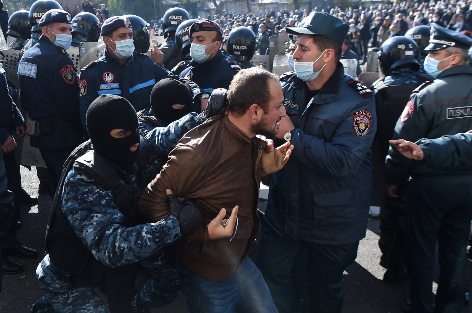 A man is taken away by law enforcement officers during an opposition rally to demand the resignation of Armenian Prime Minister Nikol Pashinyan following the signing of a deal to end the military conflict over the Nagorno-Karabakh region, in Yerevan, Armenia Nov. 11, 2020. (REUTERS)