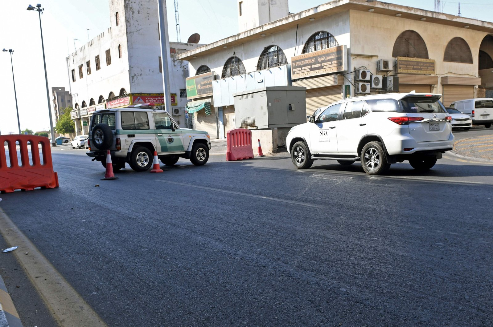 Saudi police close a street leading to a cemetery in the Saudi city of Jeddah where a bomb struck a World War I commemoration attended by European diplomats on November 11, 2020. (AFP Photo)