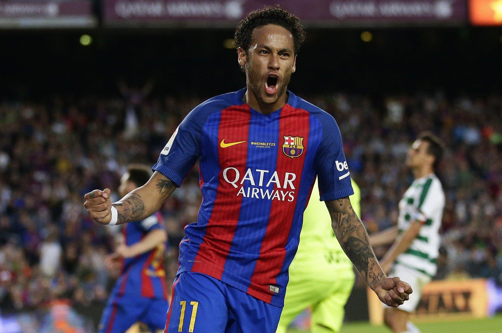 Former Barcelona player Neymar celebrates a goal during a La Liga match against Eibar, in Barcelona, Spain, May 21, 2017. (AP Photo)