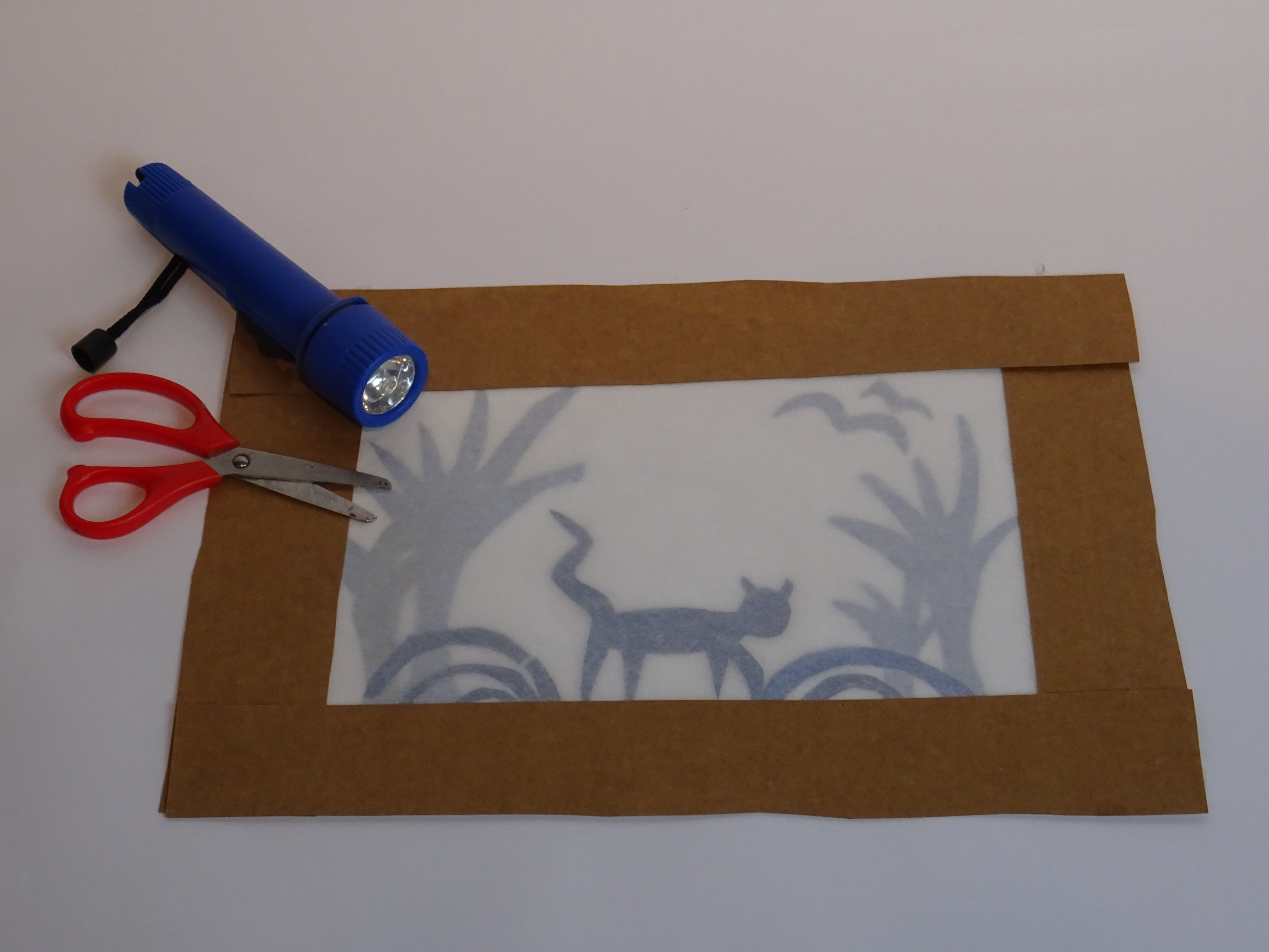 In the Art with Shadows workshop, children observe how their work changes in different lights