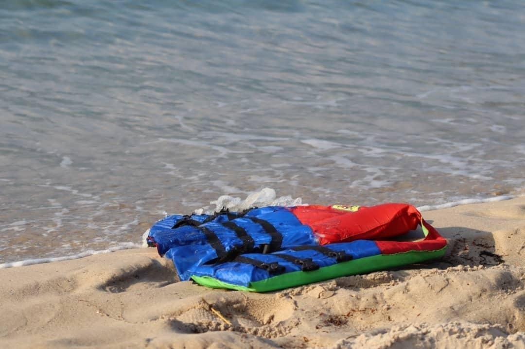 A life jacket litters the beach off the coast of Libya near the port of al-Khums, Nov. 12, 2020. (IOM via AP)