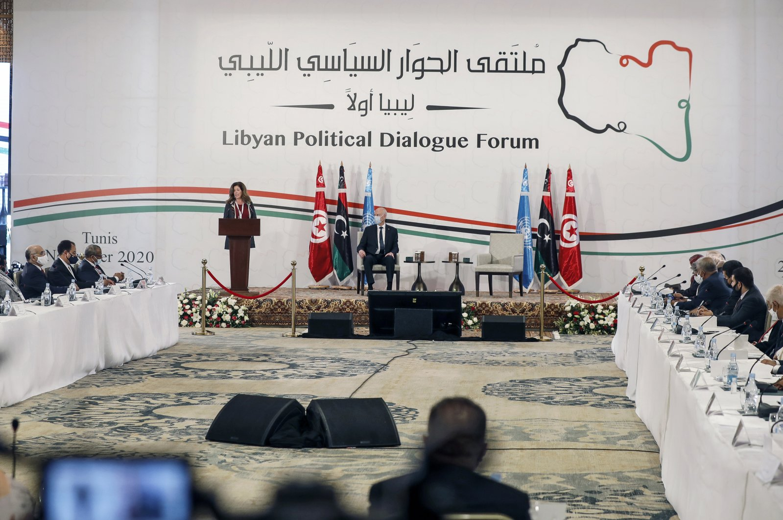 Stephanie Williams (L), the acting special representative of the secretary-general and head of the United Nations Support Mission, and Tunisian President Kais Saied attend the opening ceremony of Libya's peace talks in Tunis, Tunisia, Nov. 9, 2020. (AP Photo)