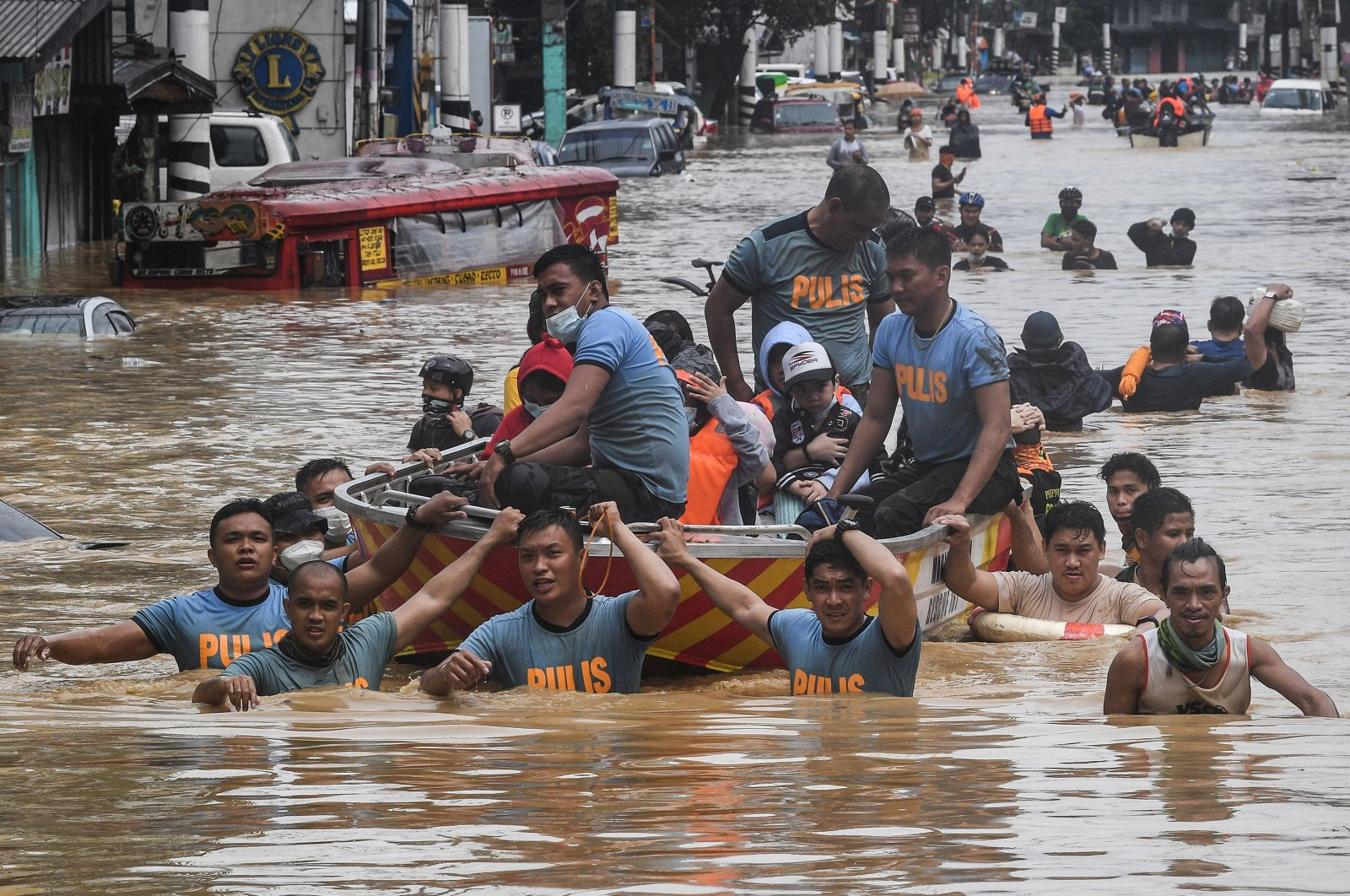 Rescuers pull a rubber boat carrying residents through a flooded street after Typhoon Vamco hit in Marikina City, suburban Manila, Nov. 12, 2020. (AFP Photo)