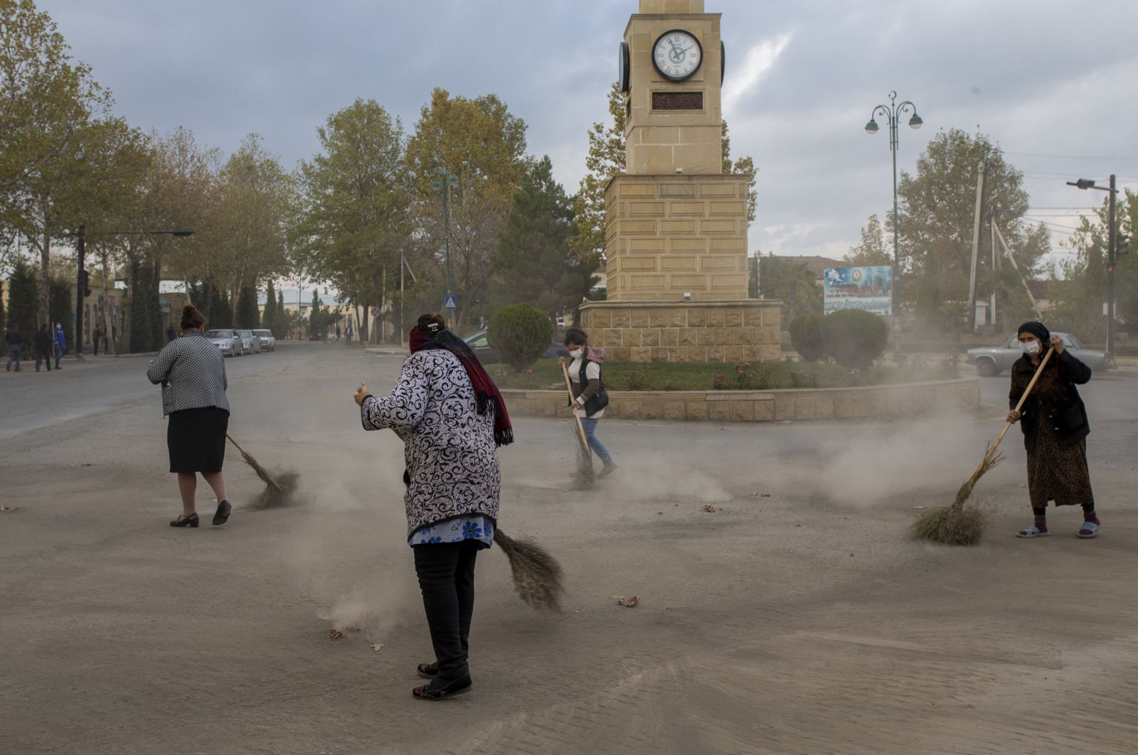 Local residents clean the streets in the Azerbaijani city of Tartar, Nov. 11, 2020. (AA Photo)