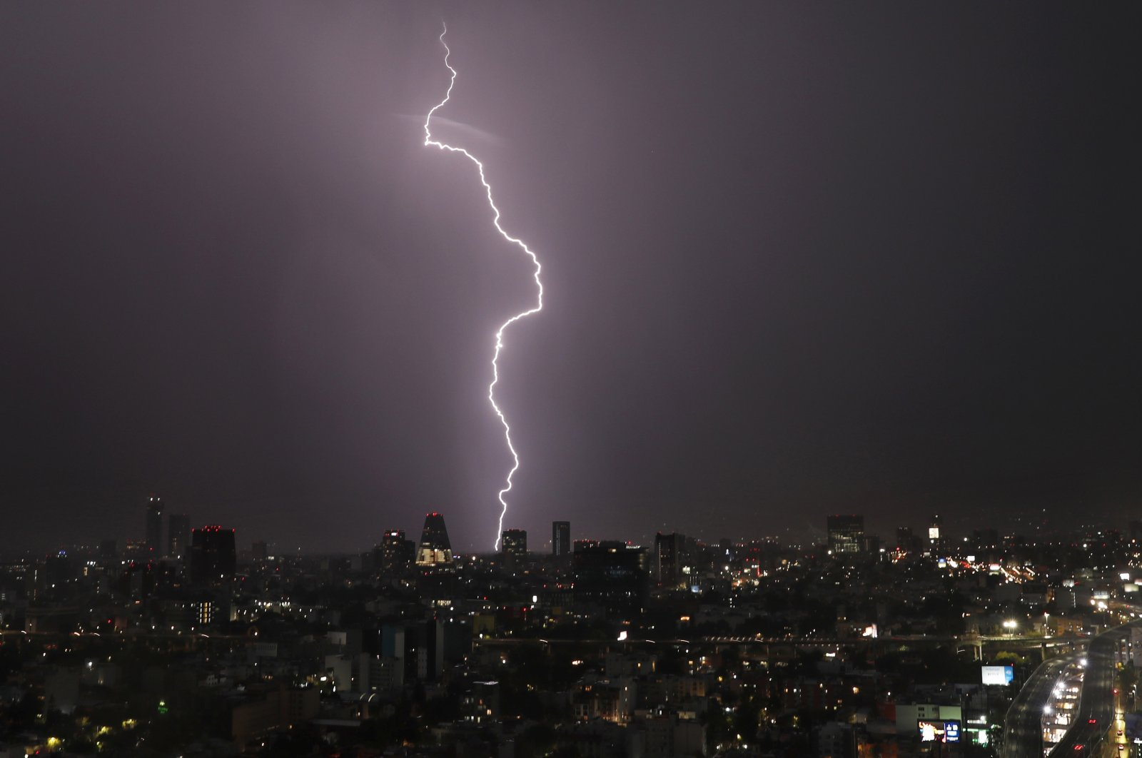 A bolt of lightning strikes during a storm in Mexico City, Mexico, July 18, 2020. (AP Photo)
