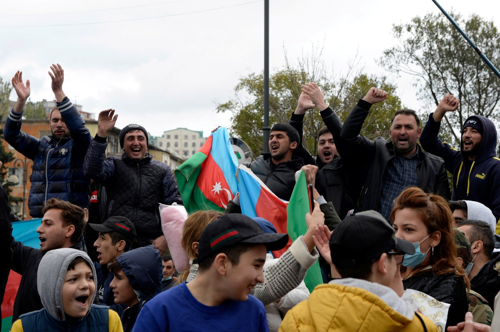 People celebrate on the streets after Azerbaijani President Ilham Aliyev said the country's forces had taken Shusha, during the fighting over the region of Nagorno-Karabakh, in Baku, Azerbaijan, Nov. 8, 2020. (Reuters Photo)