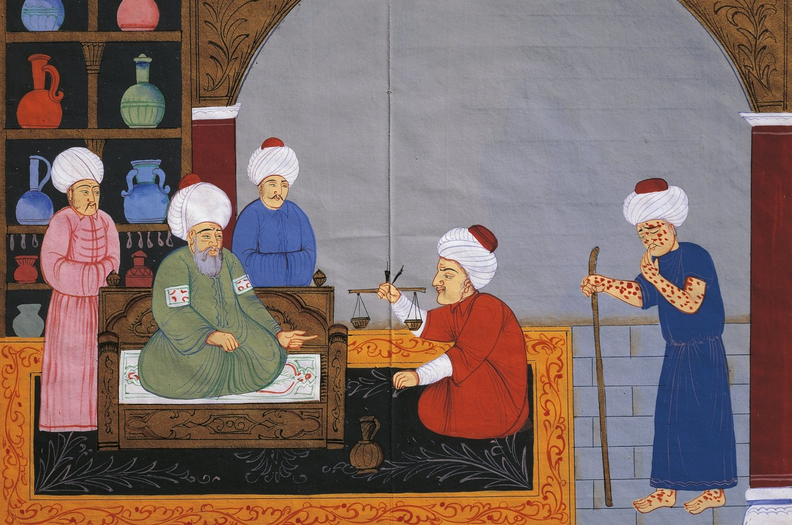 """Preparation of medicines for the treatment of a patient suffering from smallpox, miniature from """"The Canon of medicine,"""" by Avicenna (980-1037), Ottoman manuscript in 17th century Istanbul. (Istanbul University Library/Photo by DeAgostini/Getty Images)"""