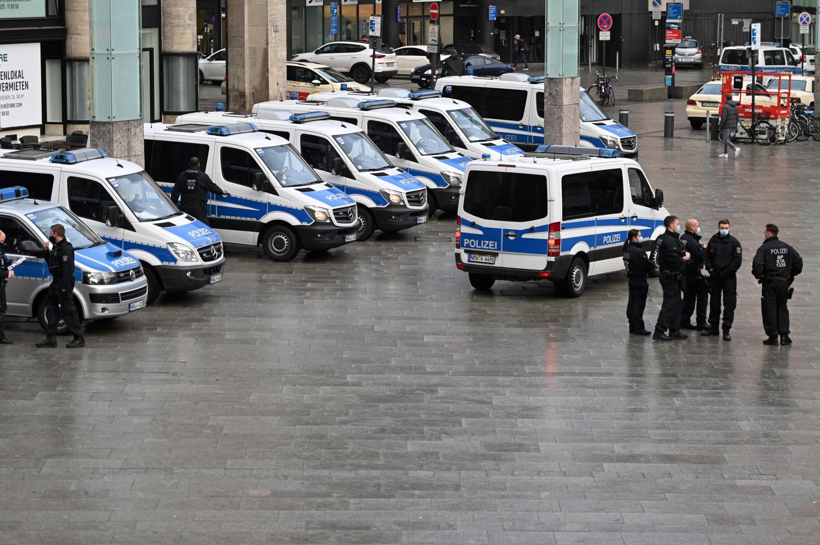 Police cars parked at the main railway station in Cologne, western Germany, Nov. 11, 2020. (AFP Photo)