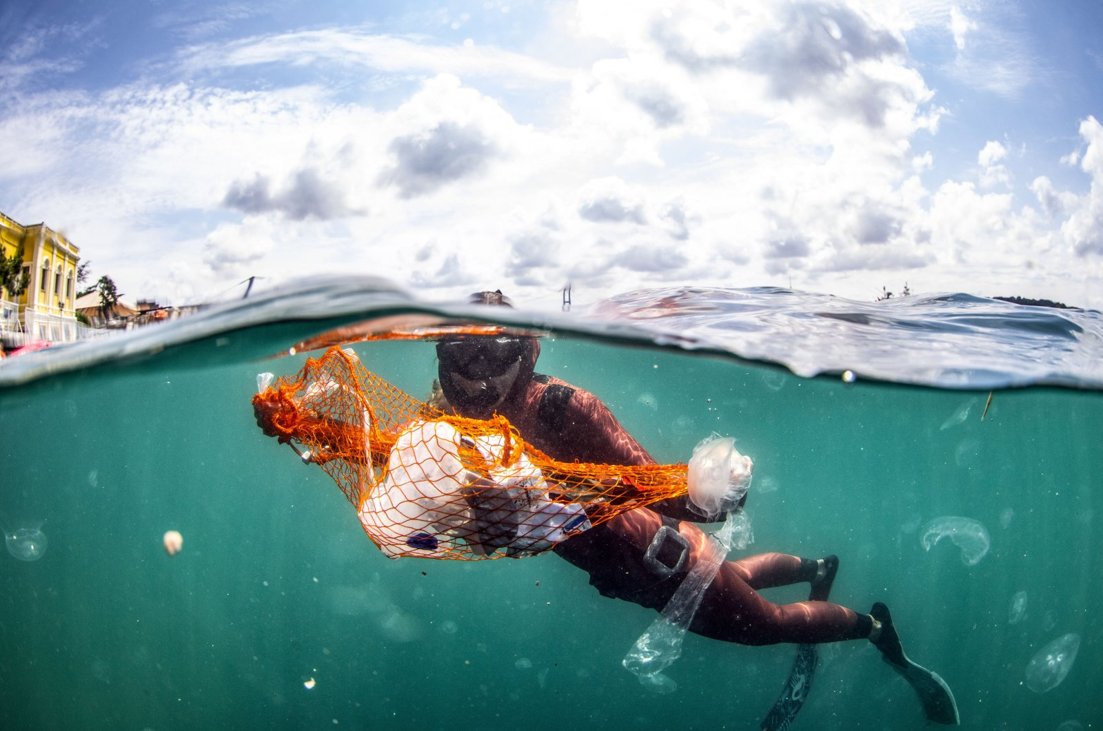 World record holder Turkish free diver Şahika Encümen dives into the Marmara Sea to promote the Zero Waste project, Istanbul, Turkey, July 1, 2020. (AA Photo)