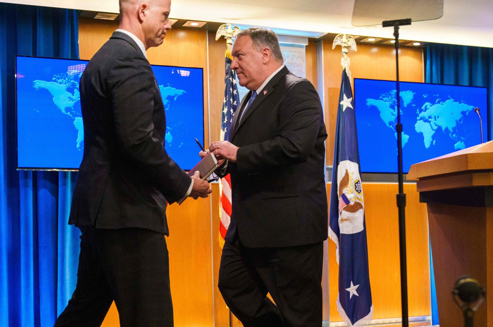 U.S. Secretary of State Mike Pompeo (R) leaves the podium after giving a media briefing at the State Department in Washington, D.C., Nov. 10, 2020. (AFP Photo)