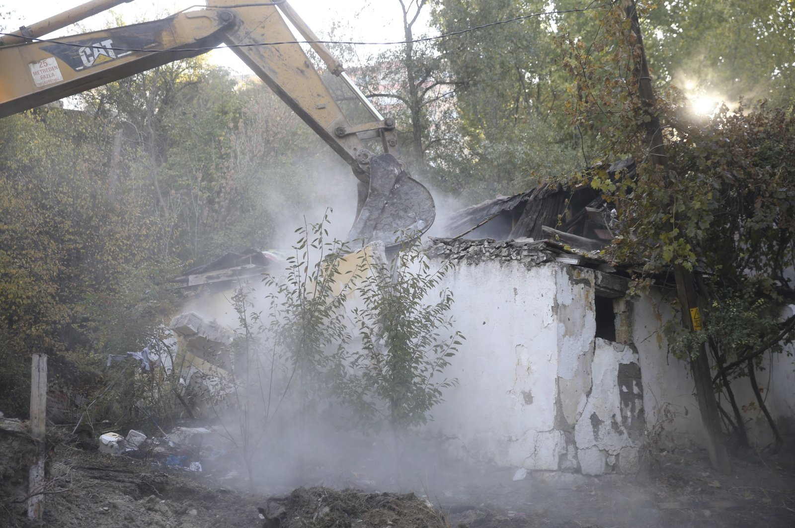 A bulldozer tears down an abandoned house in the capital Ankara, Turkey, Nov. 12, 2020. (AA Photo)