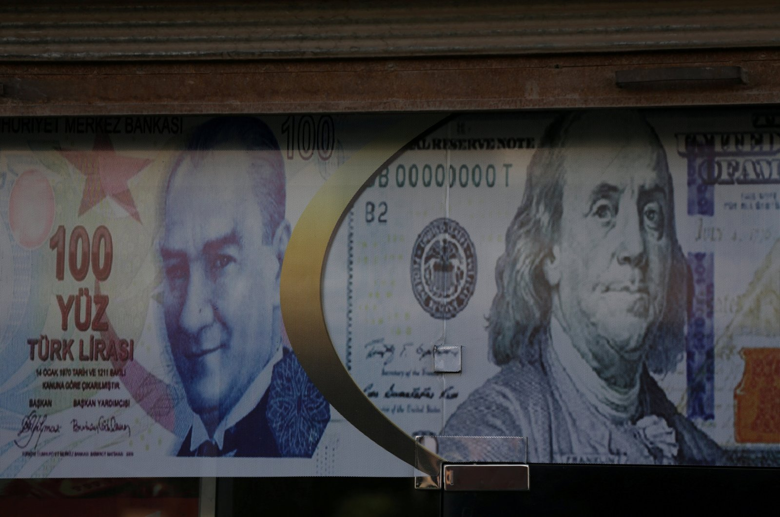 Posters of the U.S. dollar and Turkish lira are seen on a currency exchange shop in the city of Azaz, Syria, Aug. 18, 2018. (Reuters Photo)